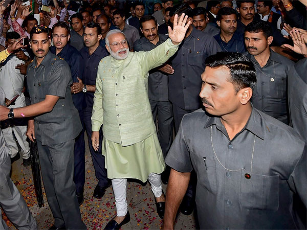 Prime Minister Narendra Modi, surrounded by security personnel
