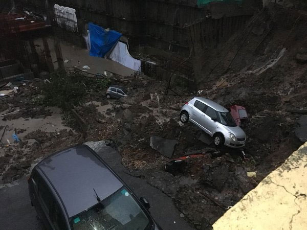 Cars were damaged after wall of an under construction building collapsed on Vidyalankar road in Mumbai. Courtesy: ANI news