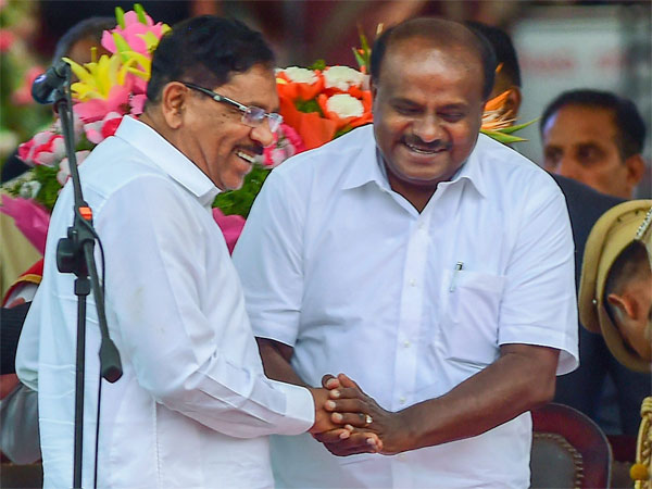 Karnataka Chief Minister and JD(S) leader H D Kumaraswamy greets Deputy Chief Minister Dr Parameshwar