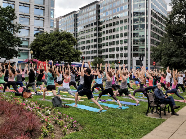 People gather to perform yoga after office hours
