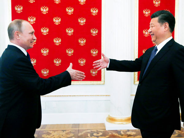 File photo of Vladimir Putin and Xi Jinping