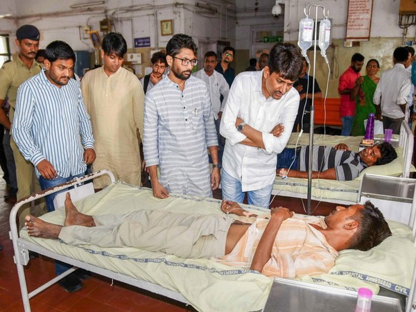 Congress MLA Alpesh Thakor, Patidar Anamat Andolan Samiti (PAAS) convenor Hardik Patel with Gujarat MLA Jignesh Mevani interact with people who were hospitalized in a critical condition after drinking country liquor, at a Civil hospital in Ahmedabad on Thursday, July 05, 2018.