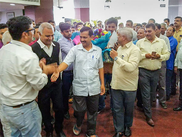 Delhi Chief Minister Arvind Kejriwal being welcomed by government and staff at Delhi Secretariat, in New Delhi