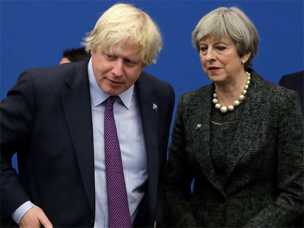 British Prime Minister Theresa May talks with British Foreign Minister Boris Johnson