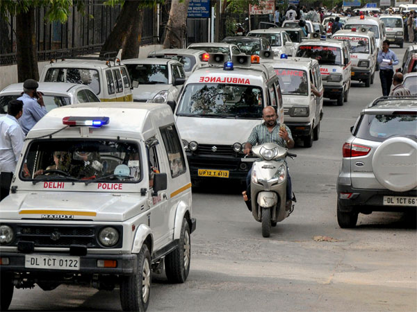 Police vehicles escort the ambulances carrying the bodies of 11 family members, who were found hanging at their residence in Burari area, to Nigambodh Ghat for cremation, in New Delhi