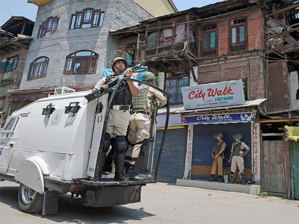Security personnel patrolling the city during strict curfew imposed on the first death anniversary of Hizbul Mujahideen commander Burhan Wani, in Srinagar