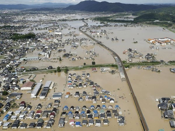 Houses are partly submerged in water, following heavy rain in Kurashiki city, Okayama prefecture, southwestern Japan, Sunday, July 8, 2018. Heavy rainfall hammered southern Japan for the third day, prompting new disaster warnings on Kyushu and Shikoku islands Sunday.AP/PTI
