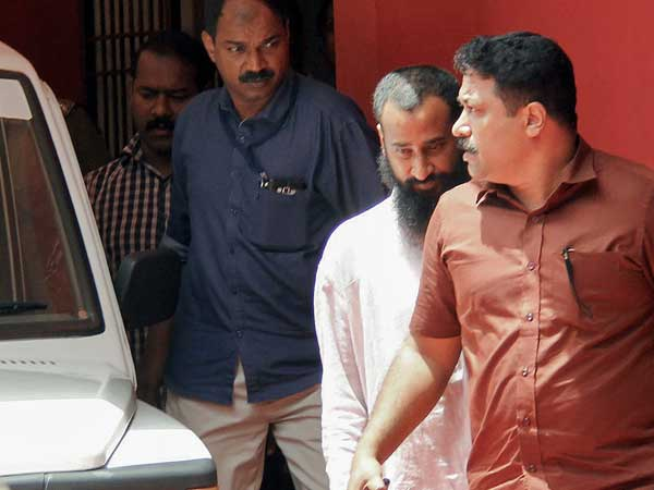 Malankara Orthodox Syrian Church priest Job Mathew (2nd R) being arrested soon after he surrendered before the Kollam Crime Branch (Image - PTI)