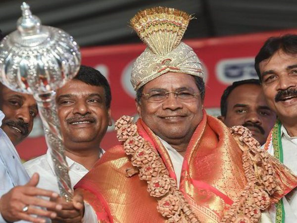 Siddaramaiah being presented with a mace