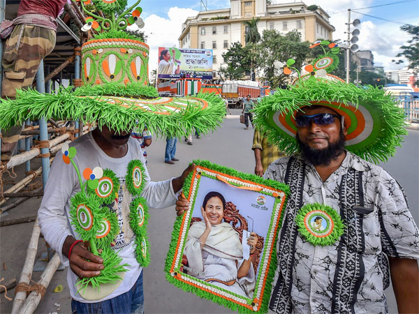 Trinamool Congress (TMC) party workers hold a portrait of West Bengal Chief Minister Mamata Banerjee ahead of the annual Martyrs' Day (Shahid diwas) rally, in Kolkata