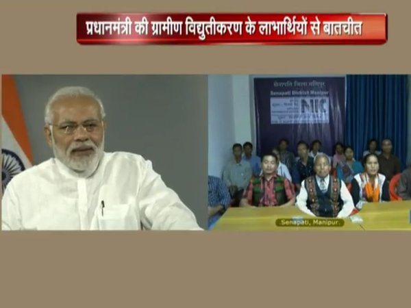 PM interacting with beneficiaries of electrification drive