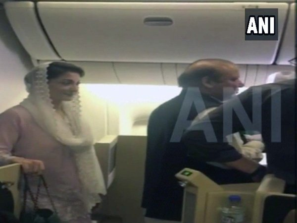 Nawaz and Maryam deboarding the plane at Lahore (Image courtesy - ANI/Twitter)