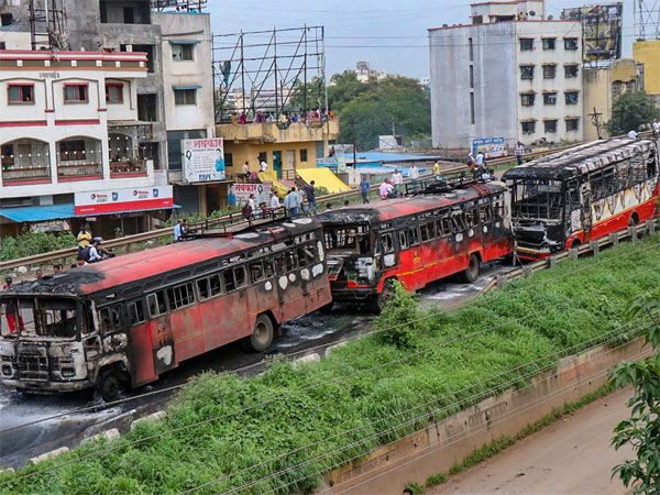 Maratha Kranti Morcha activists set ablaze buses during their district bandh called for reservations in jobs and education, near Pune, Maharashtra