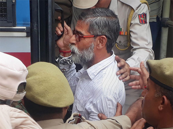 Sanji Ram, one of the eight accused in the alleged Kathua rape and murder case of an eight-year-old girl, being produced before the district and sessions court, in Pathankot, Punjab