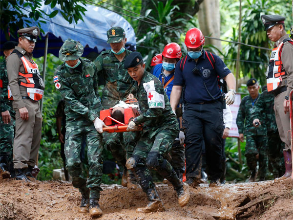 Thai soldiers hold an evacuation drill near the Tham Luang Nang Non cave in Mae Sai, Chiang Rai province, in northern Thailand