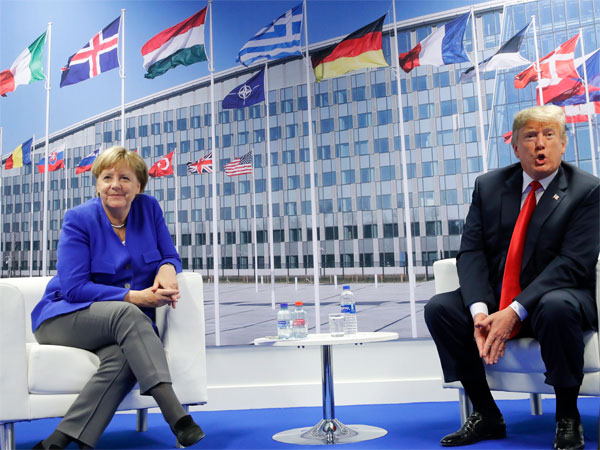 President Donald Trump and German Chancellor Angela Merkel during their bilateral meeting in Brussels