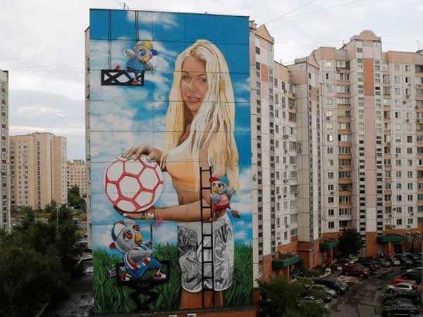 Russian art director displays wife's giant public mural in Moscow for World Cup
