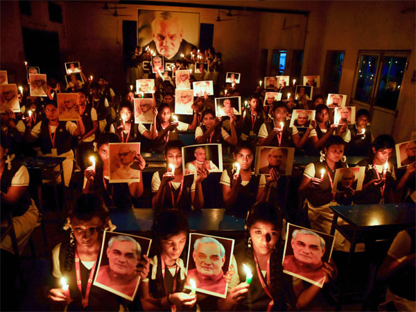 Students participate in a candlelight vigil to pay tribute to former prime minister Atal Bihari Vajpayee