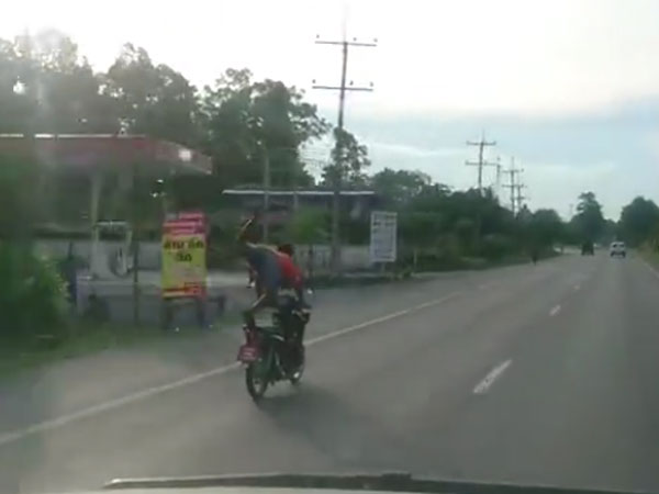 This man is flying on his motorcycle