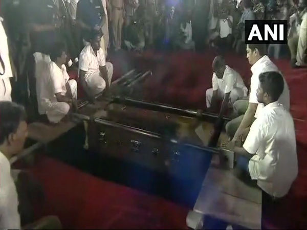 Karunanidhi laid to rest with full-state honours at Marina Beach, next to Anna memorial