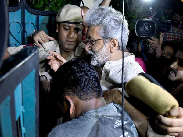Human rights activist Gautam Navlakha at his residence after his arrest in New Delhi. (Image: PTI)