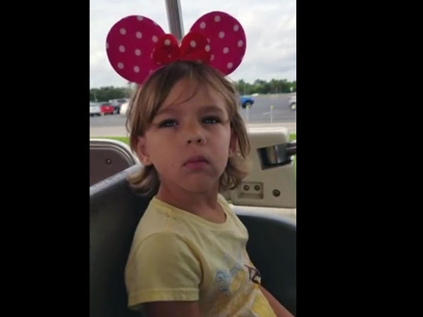 This little girl suddenly discovers that she is entering Disney World; her reaction is priceless