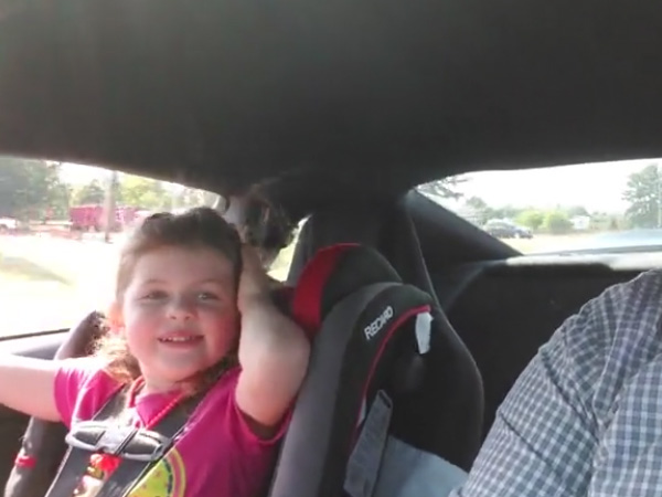This 4-year-old girl has a craving for speed & she asks her dad to drive even faster!