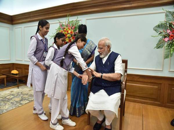 School girls tie Rakhi to PM Modi