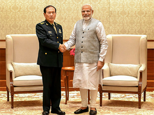 Prime Minister Narendra Modi shakes hands with Defence Minister of China, General Wei Fenghe during a meeting in New Delhi