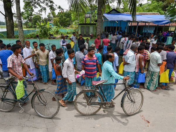 People wait to check their names on the final draft of the states National Register of Citizens after it was released, at a NRC Seva Kendra in Nagaon
