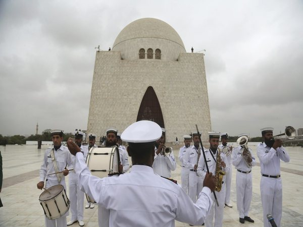 Soldiers of Pakistan Navy play the national anthem at the mausoleum of Muhammad Ali Jinnah, founder of Pakistan, to celebrate the Independence Day in Karachi, Pakistan (Image credit - PTI)