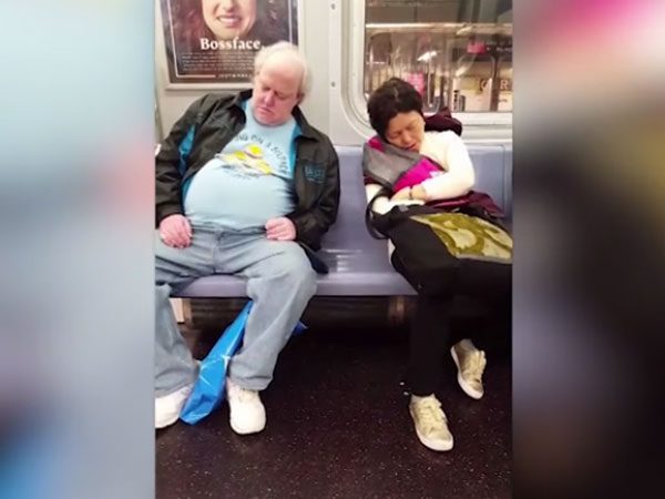 Is there something invisible that is pulling these 2 sleeping passengers to each other?