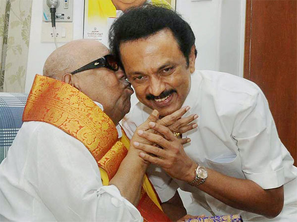 A file picture of DMK chief M Karunanidhi with his son MK Stalin