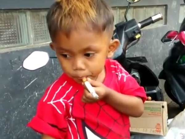This two-year-old needs two packs of cigarettes every day, else he gets upset