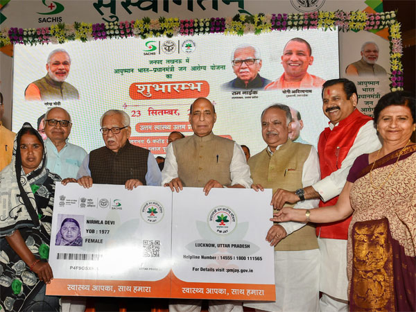 Union Home Minister Rajnath Singh flanked by UP Governor Ram Naik (L) and UP Assembly Speaker Hriday Narayan Dixit at the launch of Ayushman Bharat-National Health Protection Mission
