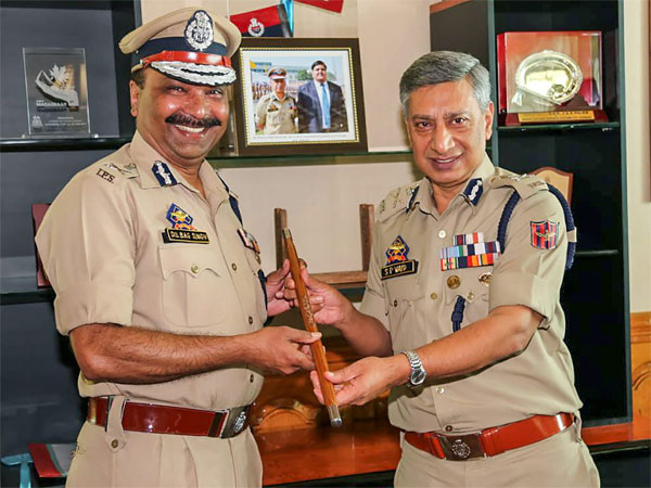 Former Director General of Police SP Vaid passes on the baton as Dilbag Singh takes over as DGP at Police Headquarter, in Srinagar
