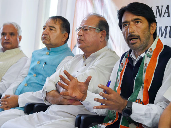 J & K Congress President Ghulam Ahmad Mir with other senior leaders addresses a a press conference in Srinagar