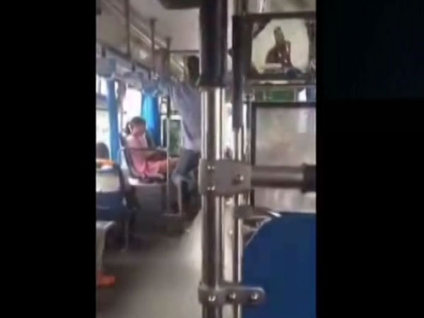 This bus driver can't remain idle even when his vehicle stops at red signal