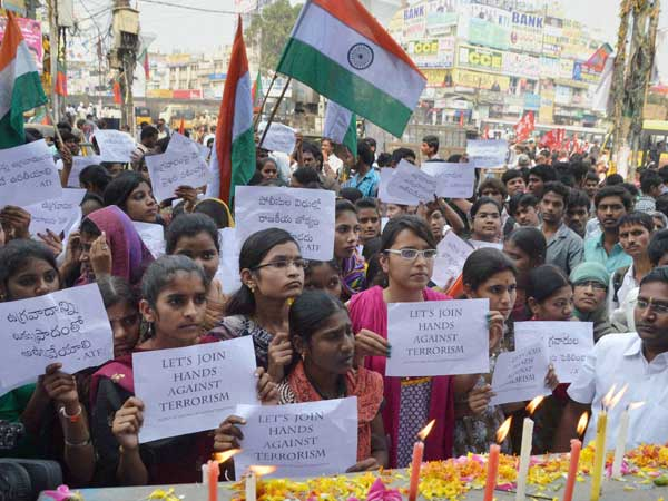 Students holding placards and national flags while paying tributes to the victims on 1st Anniversary of Dilsukhnagar twin bomb blasts in Hyderabad. (2014-02-21) PTI file photo