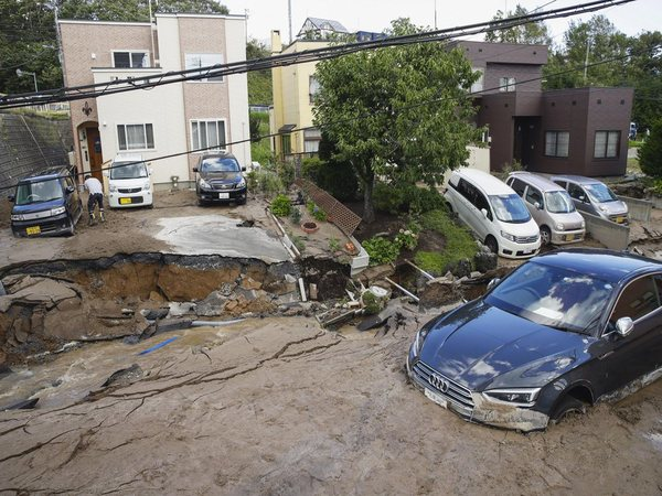 Cars stuck in mud covered road after earthquake