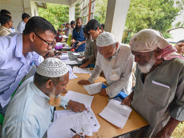 People check their names on the final draft of the states National Register of Citizens after it was released, at a NRC Seva Kendra in Nagaon