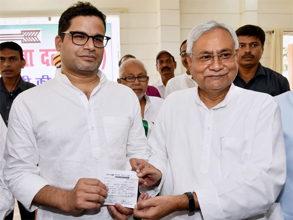 Bihar Chief Minister and Janta Dal United JD(U) National President Nitish Kumar greets electoral strategist Prashant Kishor after he joined JD(U) during partys state executive meeting at Anne Marg, in Patna