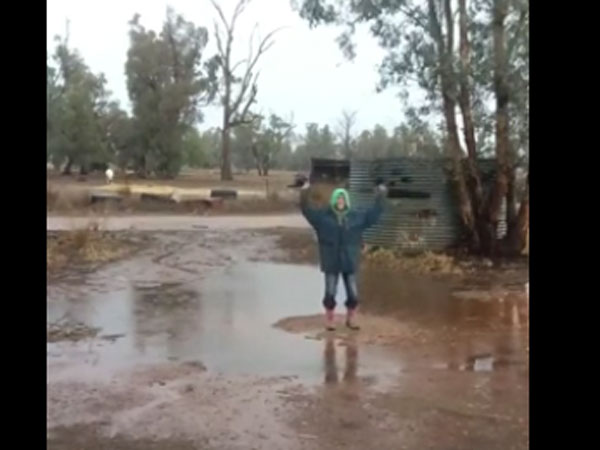 Rain makes this woman dance and she has a valid reason to celebrate