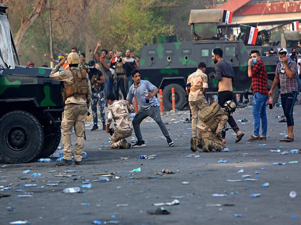 Security forces affected by tear gas are helped by several protesters during demonstrations. PTI file photo