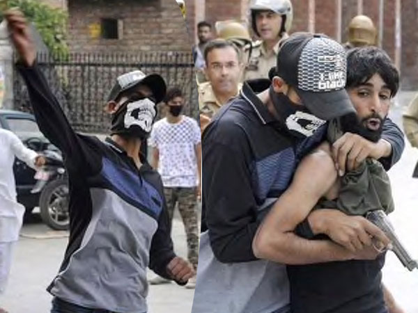 Cops disguised as stone pelters (PTI photo)