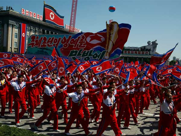 N-Korea stages huge parade, holds back advanced missiles