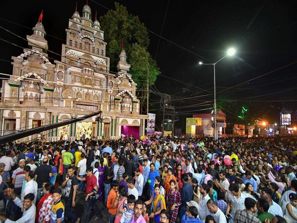 Devotees walk around the pandal