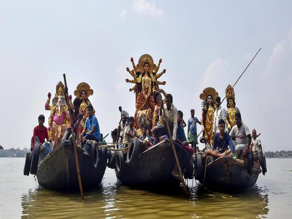 People carrying the idols of Durga