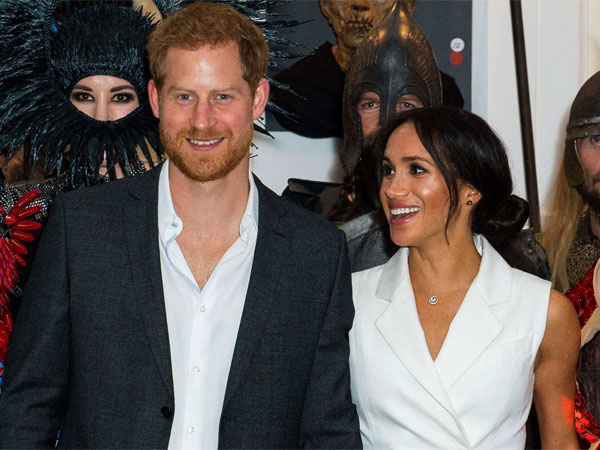 Britains Prince Harry and Meghan