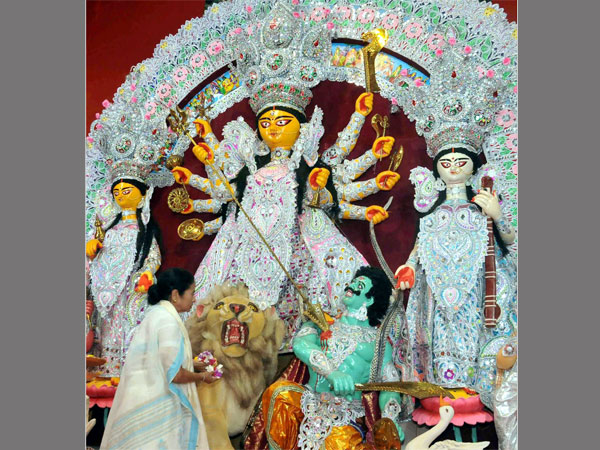West Bengal Chief Minister Mamata Banerjee offering prayer during the inauguration of Goddess Durga Puja ahead of Durga Puja festival, in Kolkata